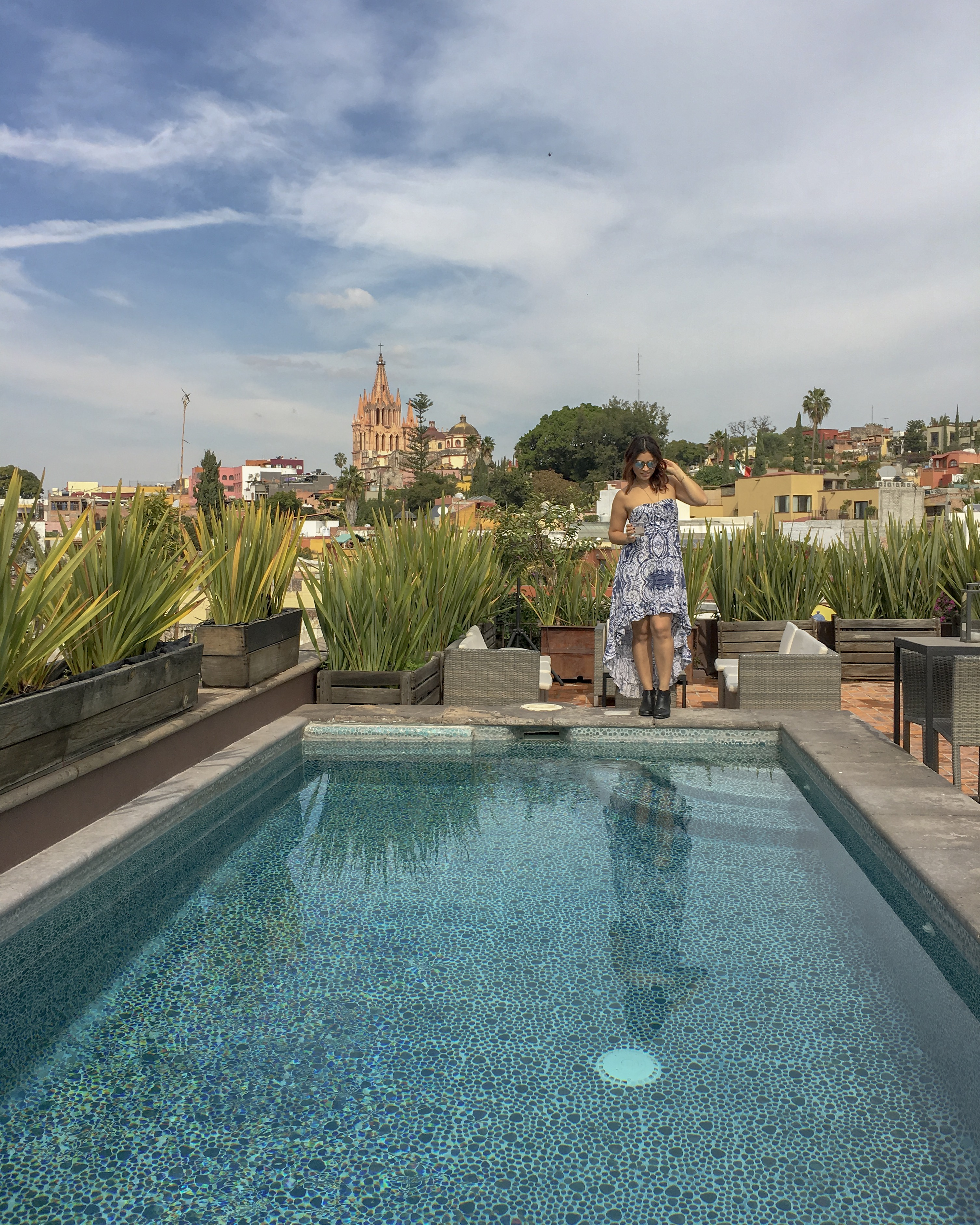 woman holding margarita rooftop pool san miguel de allende mexico