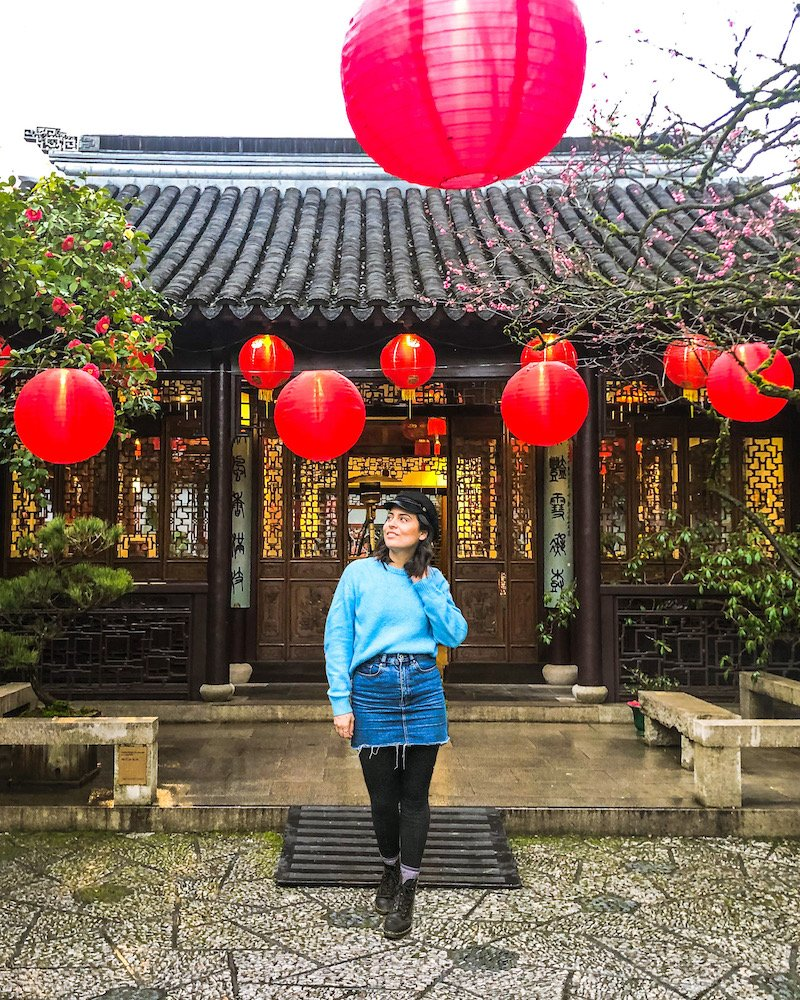 woman at lan su chinese garden portland oregon
