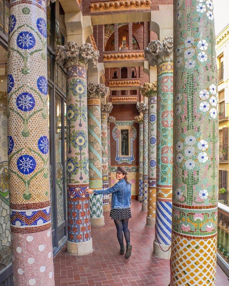 woman at mosaic pillars at palau de la musica catalana barcelona