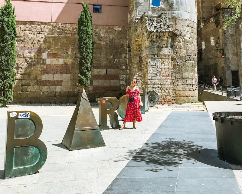 woman in red dress barcelona gothic quarter