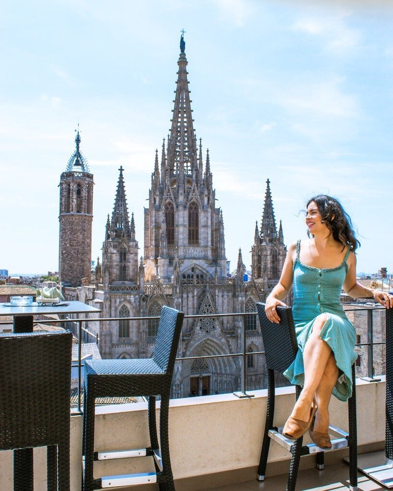woman with barcelona cathedral in background