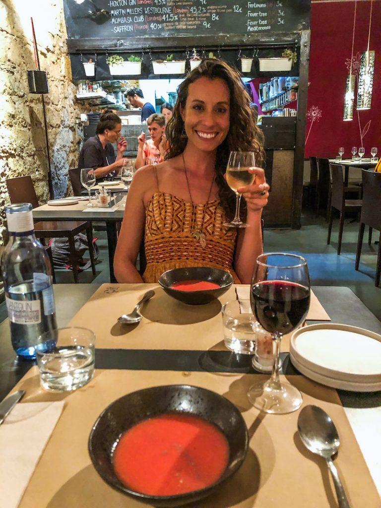 woman holding wine glass at sesamo barcelona