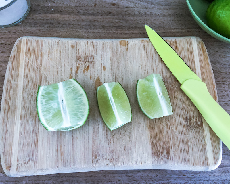 limes on cutting board Caipirinha