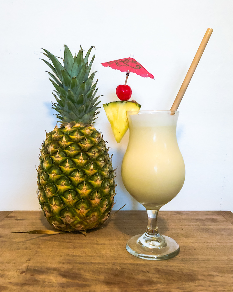 pina colada cocktail and pineapple
