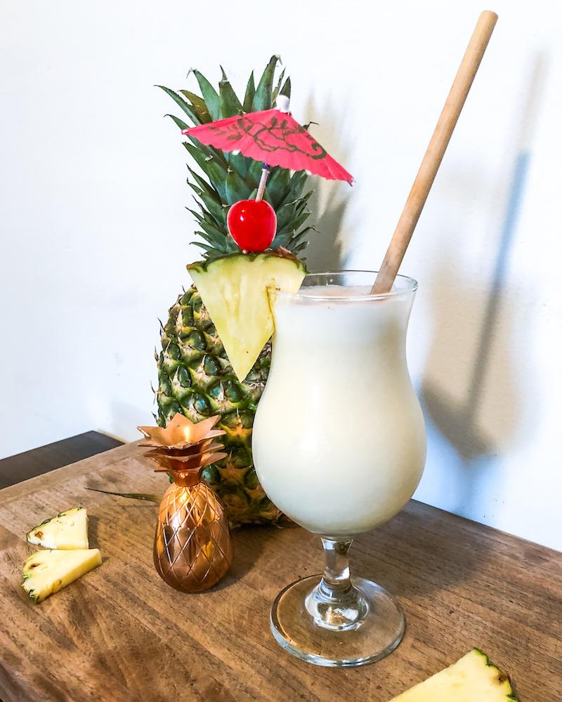 pineapple pina colada in hurricane glass