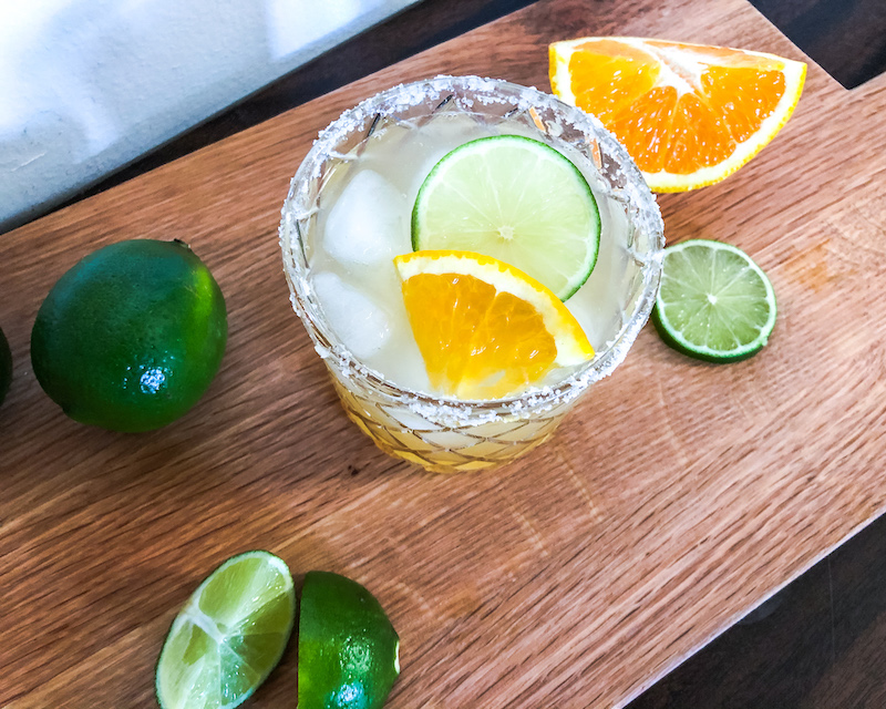 skinny margarita with salted rim lime and oranges