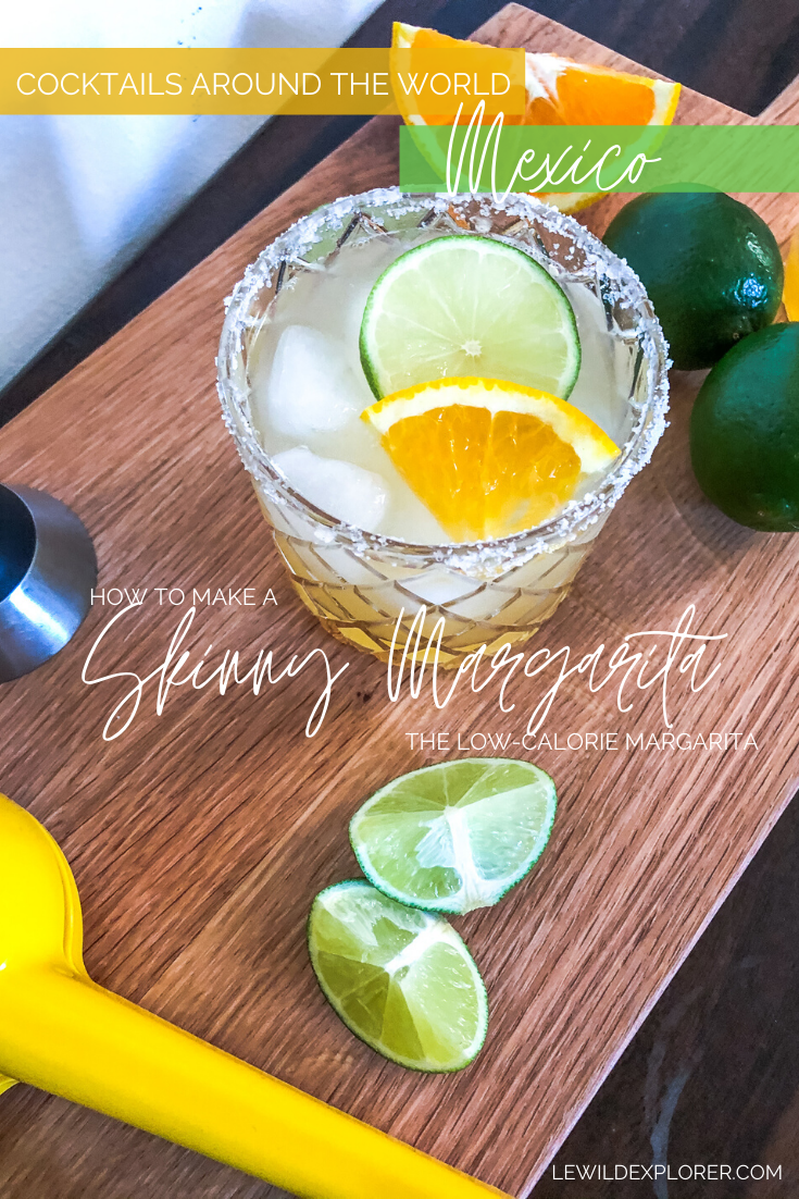 skinny margarita with salted rim and lime wedges orange wedges