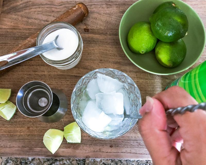 stirring a Caipirinha cocktail