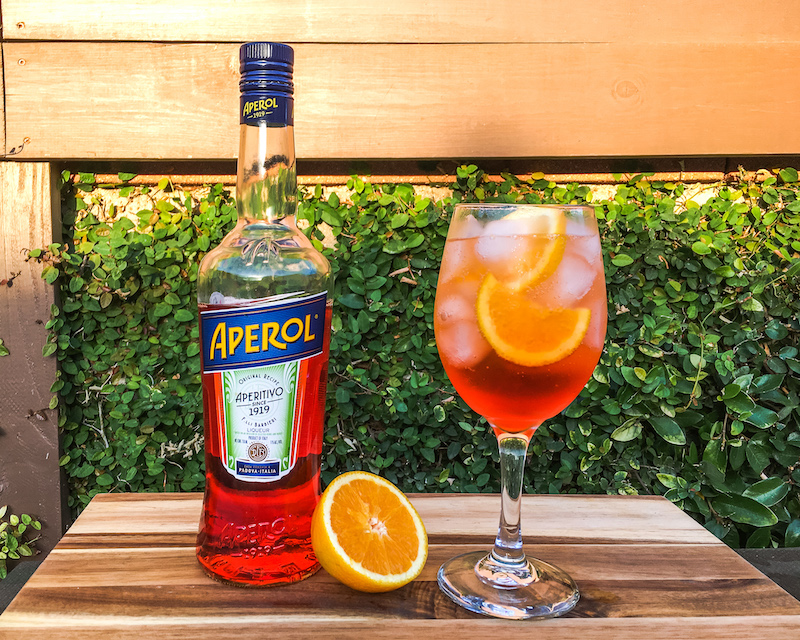 aperol spritz and aperol bottle