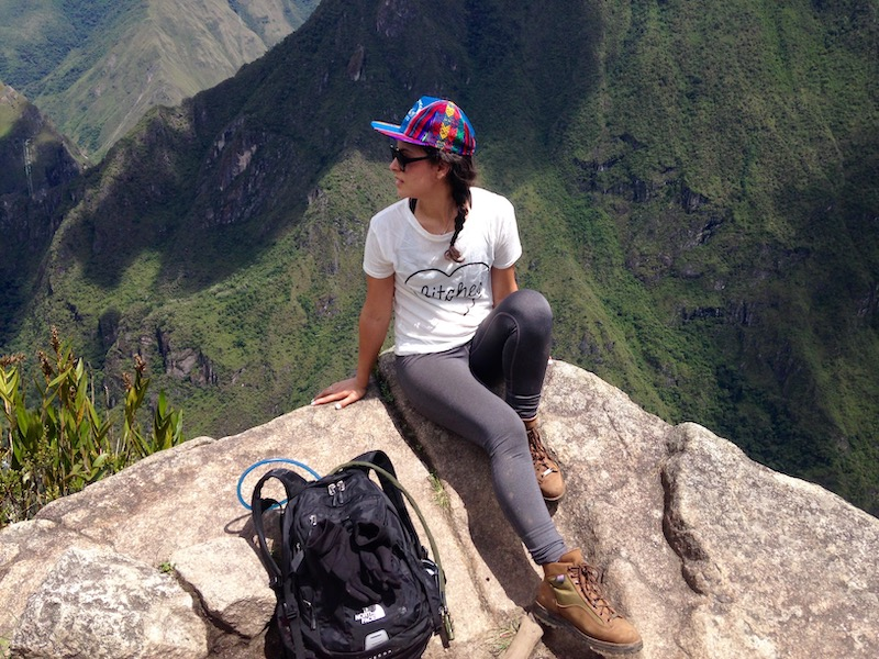 woman at top of huayna picchu hike
