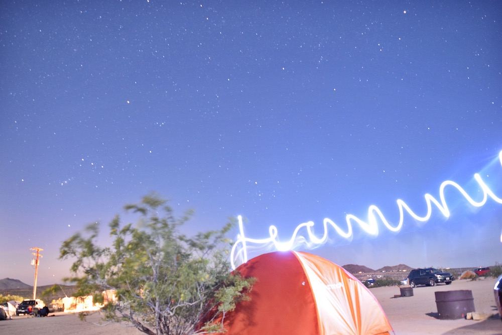 camping light writing photography with stars