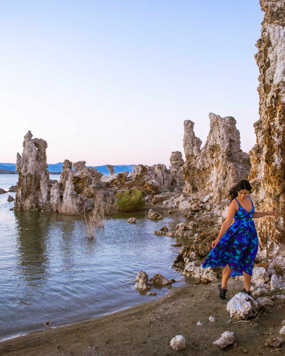 south tufa mono lake woman in blue dress sunset