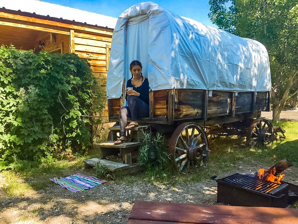 woman at covered wagon virgina creek settlement bridgeport