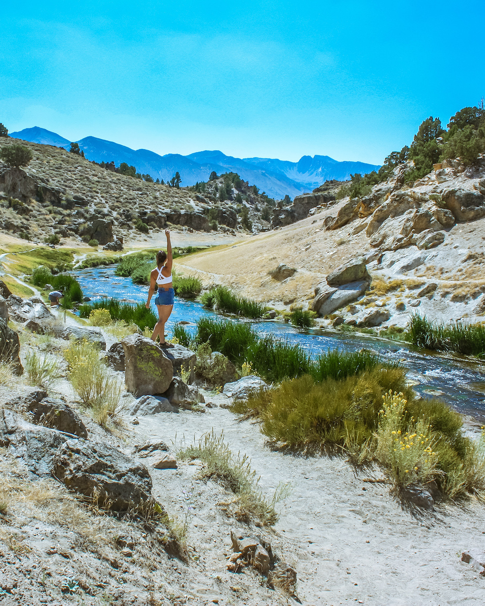 woman at hot creek geological site eastern sierras