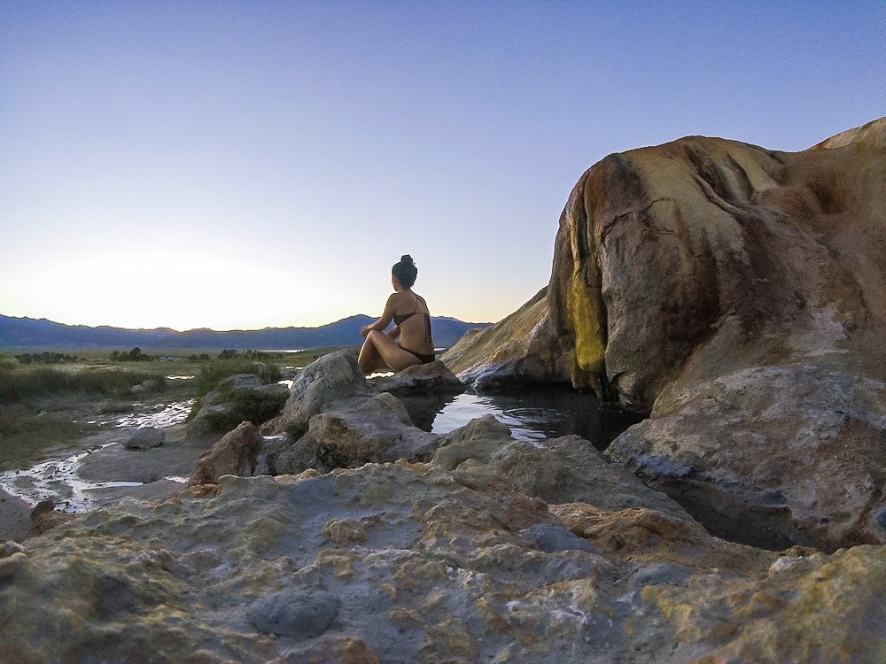 woman at travertine hot springs at sunset bridgeport