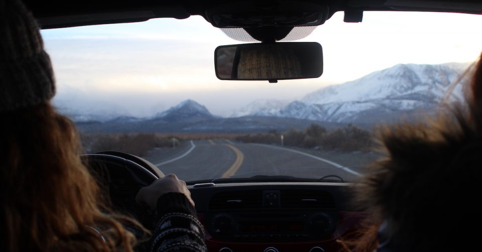 woman driving near mammoth lakes road trip