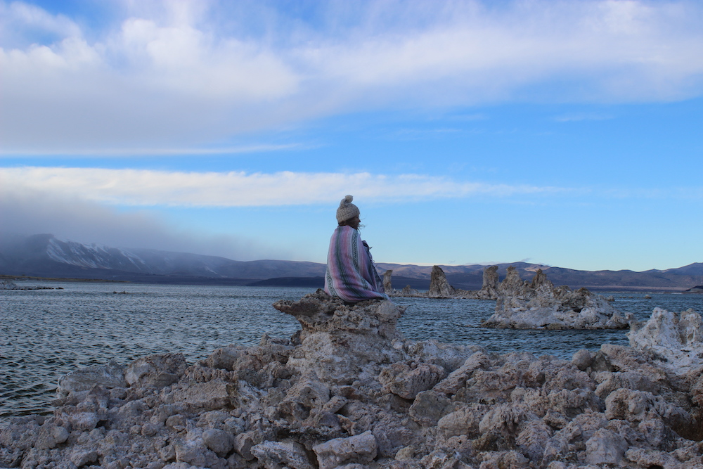 woman in colorful blanket at mono lake