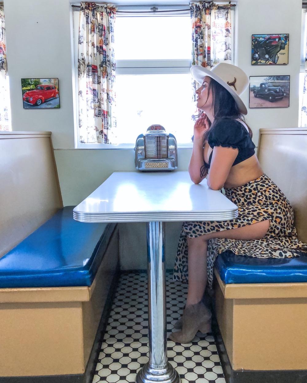 woman sitting an vintage american diner