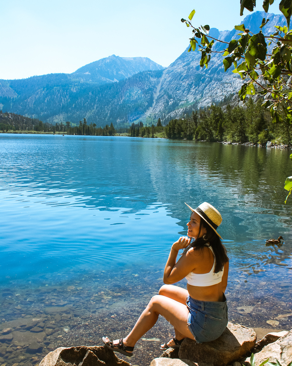 woman sitting on rocks at silver lake june lake loop