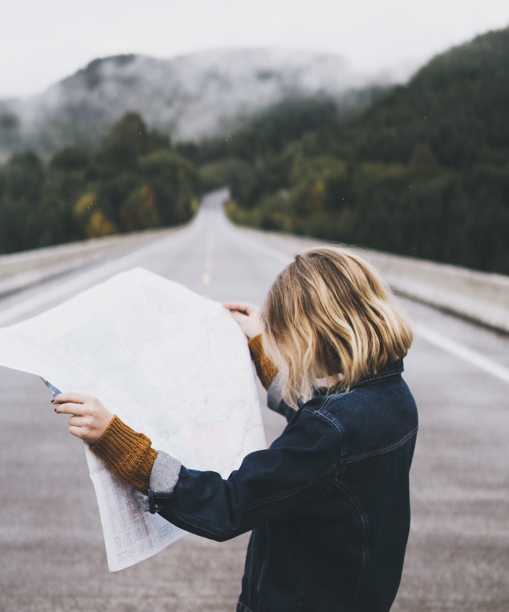 woman looking at map of self guided tour