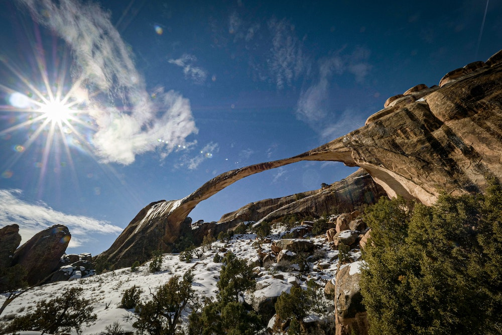 landscape arch with snow arches national park