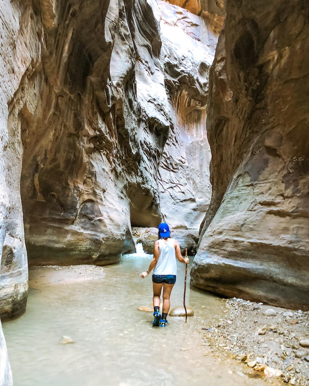 woman at the narrows hike utah zion national park