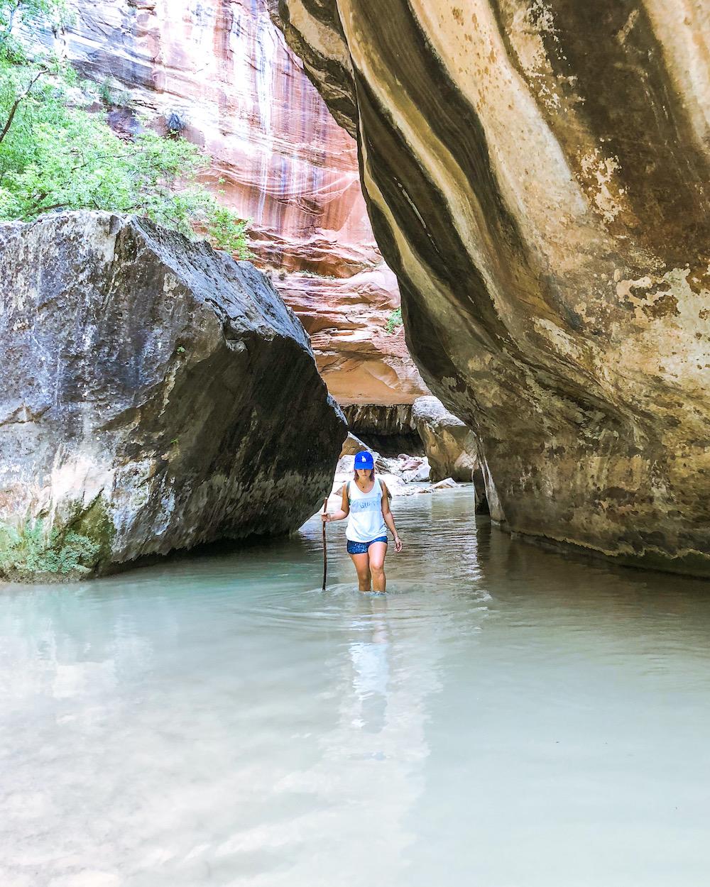 woman at the narrows hiking zion national hike utah