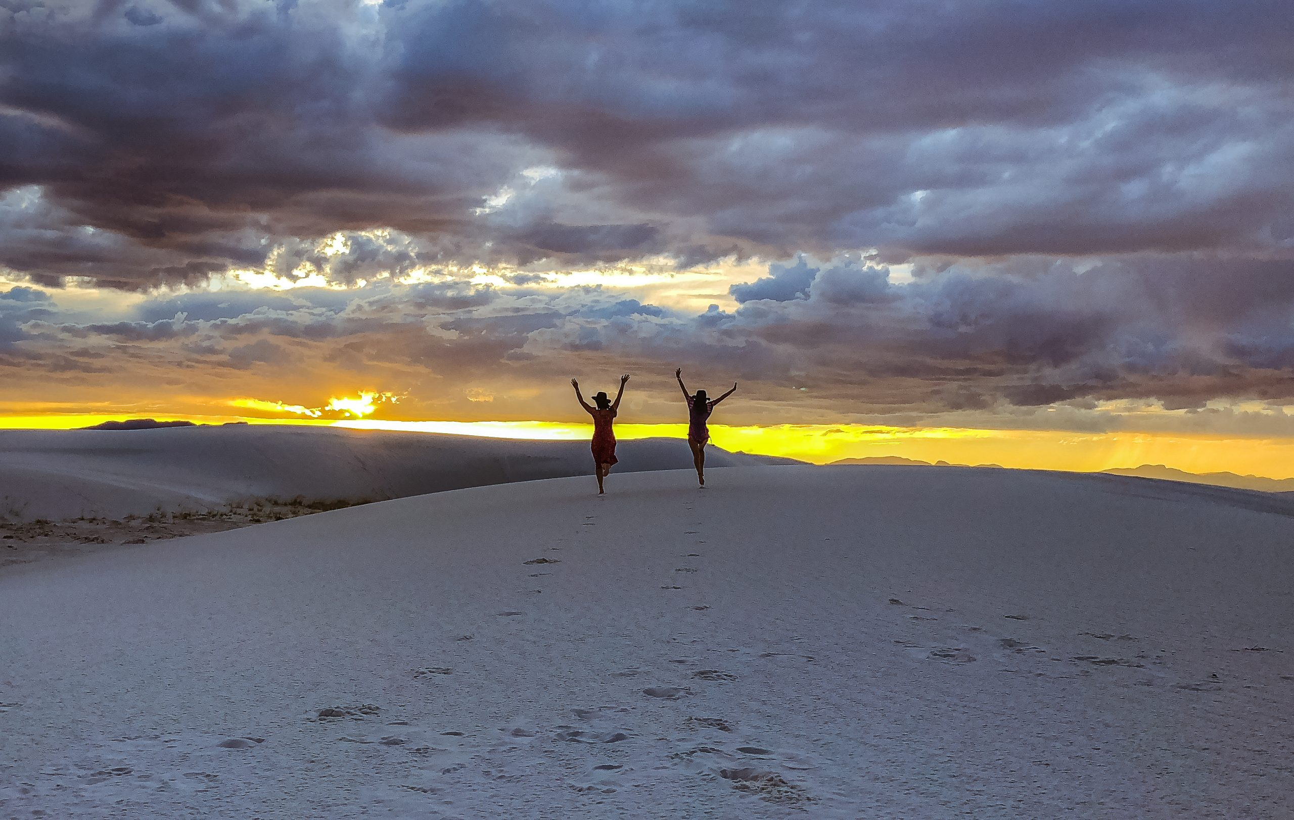 two woman at white sands new mexico sunset