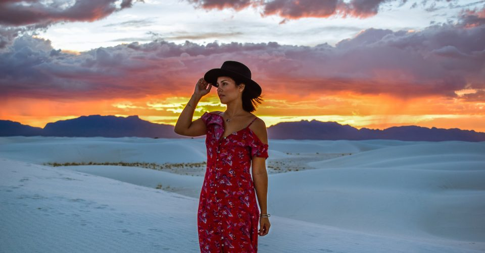 woman in red dress white sands national park sunset