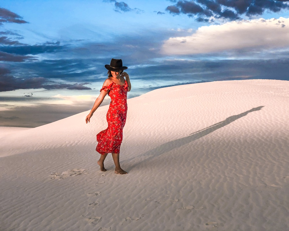 woman at white sands national park white sand dunes