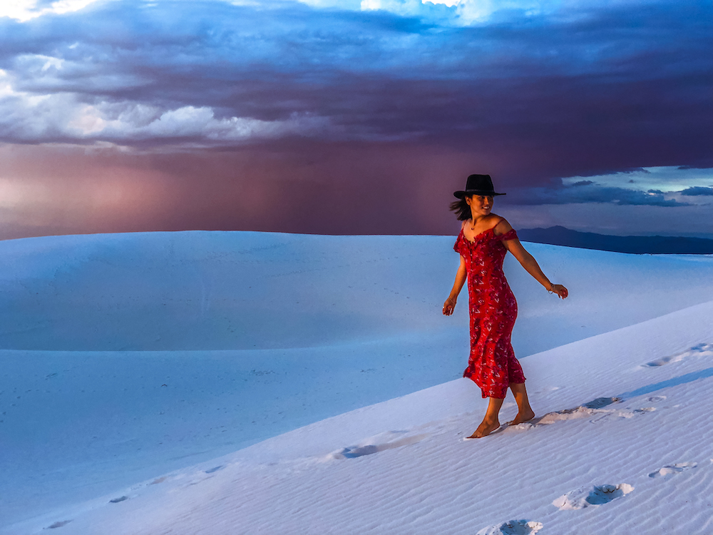 woman in red dress at white sands national park sunset