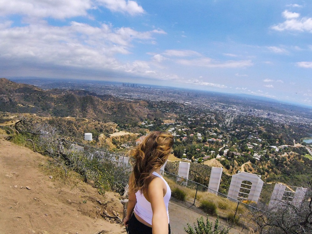 woman at Cahuenga Peak hollywood sign griffith hiking trails LA skyline hike