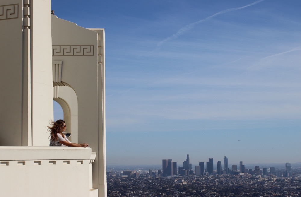 woman at Griffith Observatory downtown la skyline view