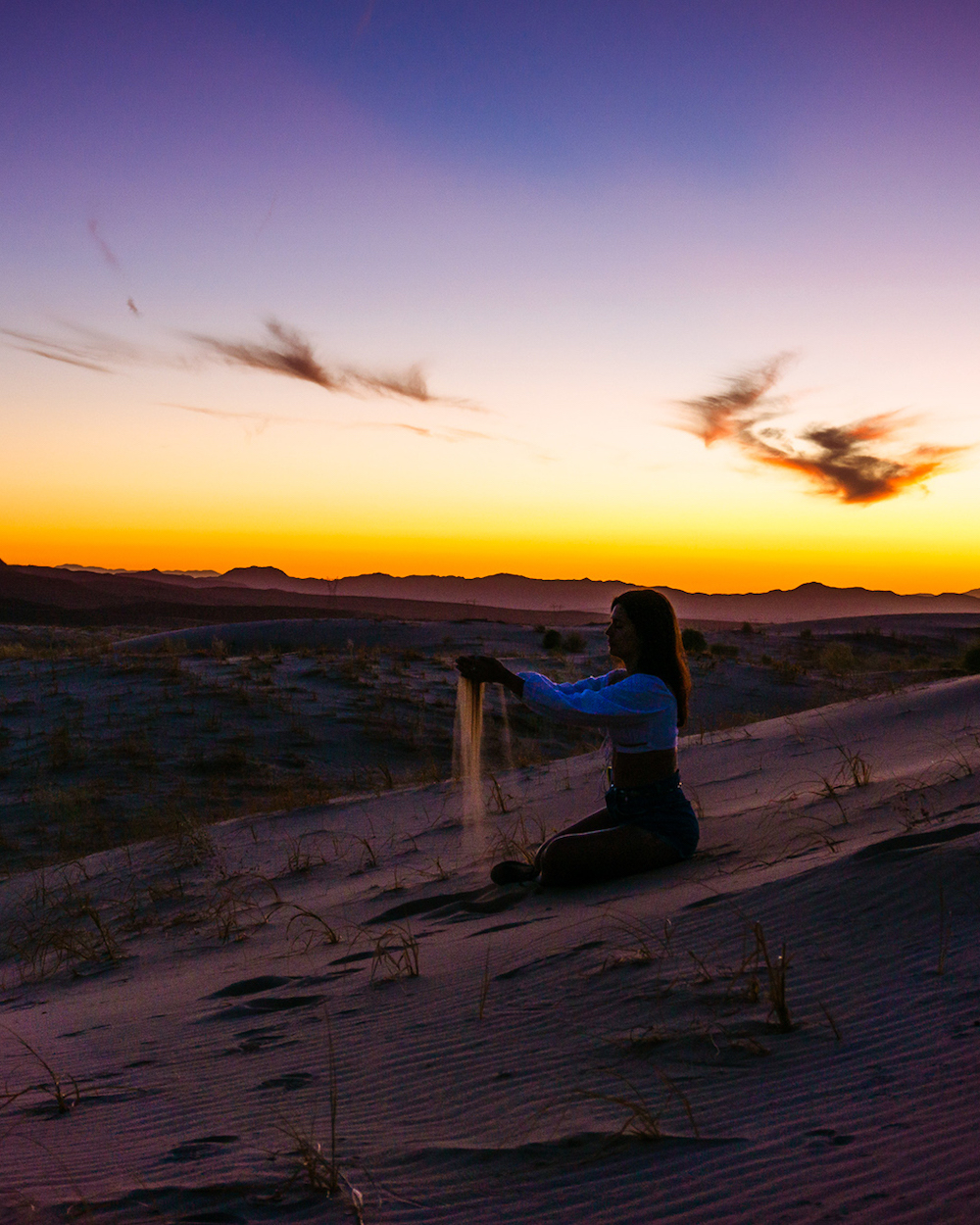 woman at Mojave kelso sand dunes at sunset