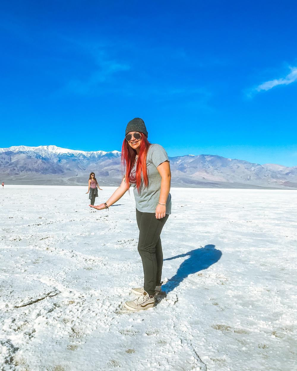 woman at badwater basin salt flats california death valley national park perspective shot