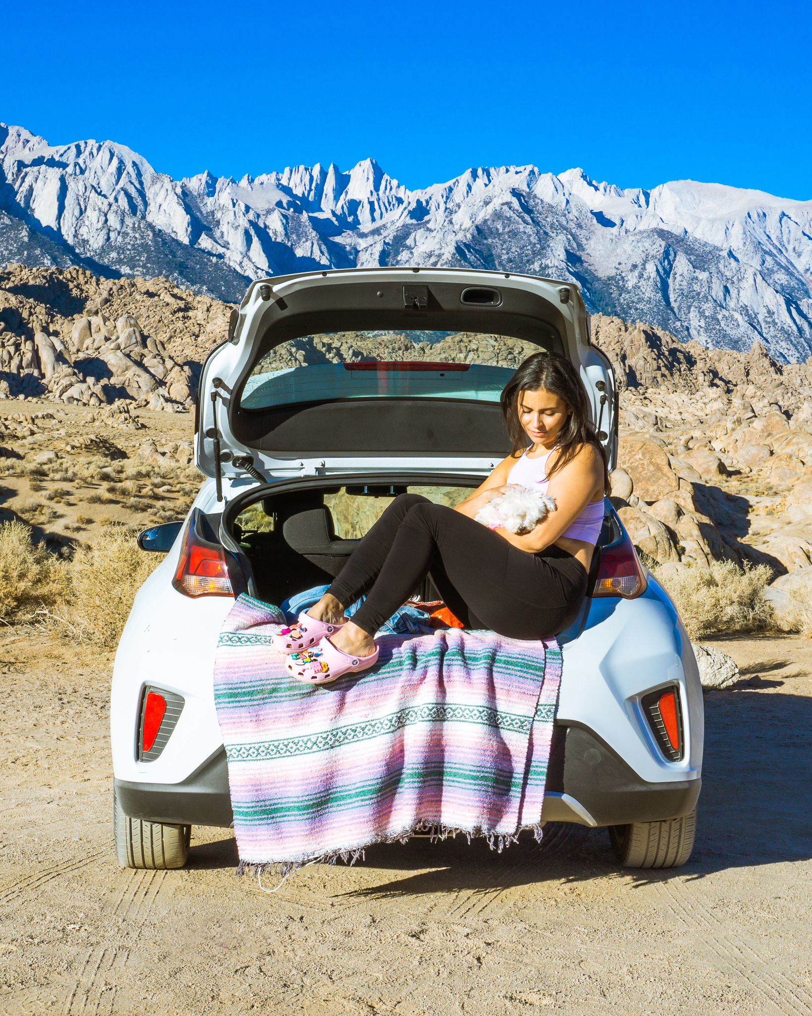 crocs sponsored post woman in car with dog mountains in background