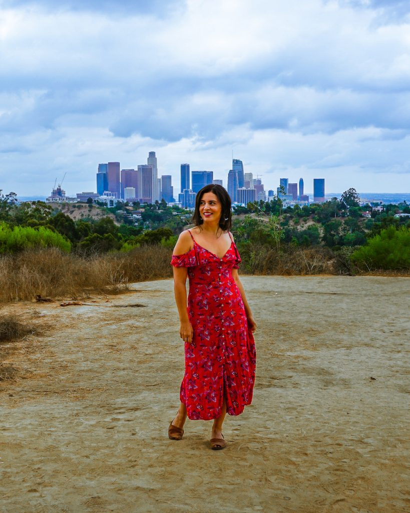 woman in red dress at los angeles skyline viewpoint from angels point elysian park