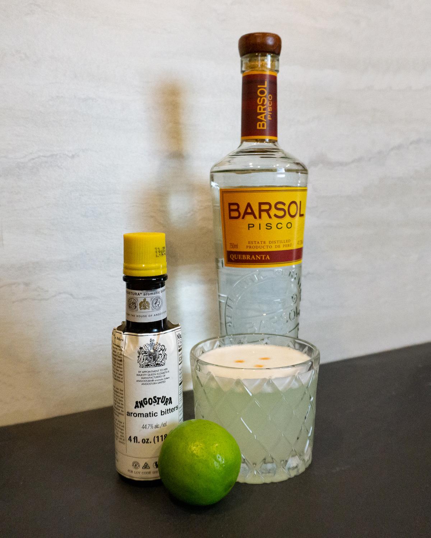 pisco sour ingredients lime bottle rocks glass