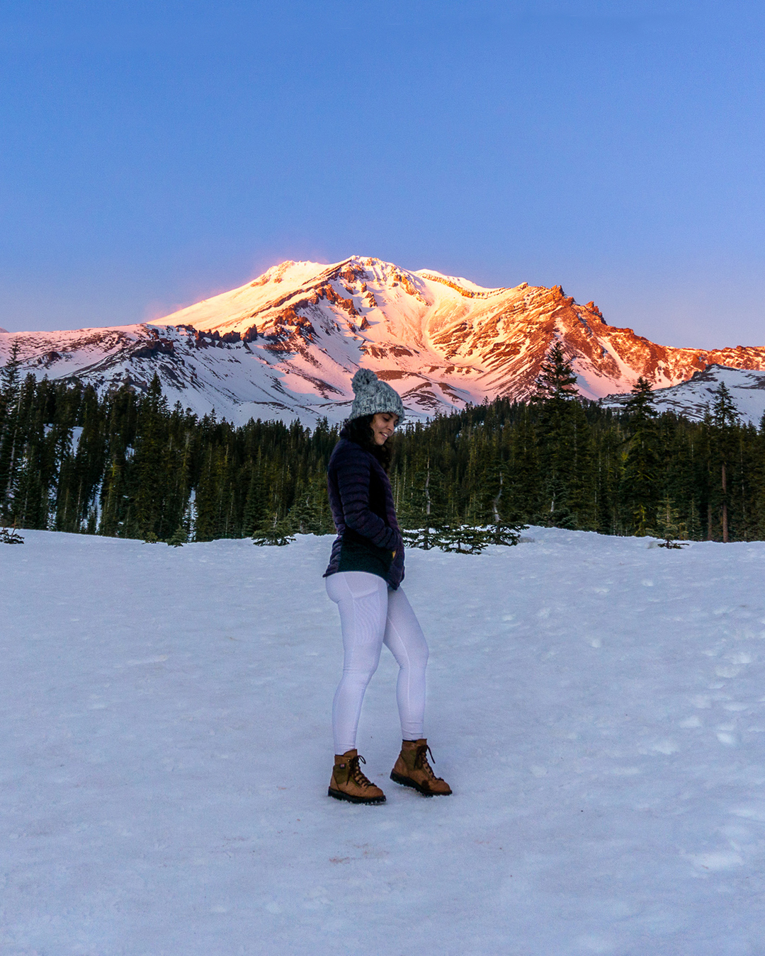 woman at mountain with view of mount shasta at sunset