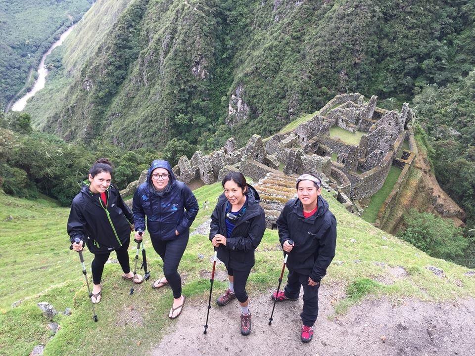 friends at incan site along inca trail in peru