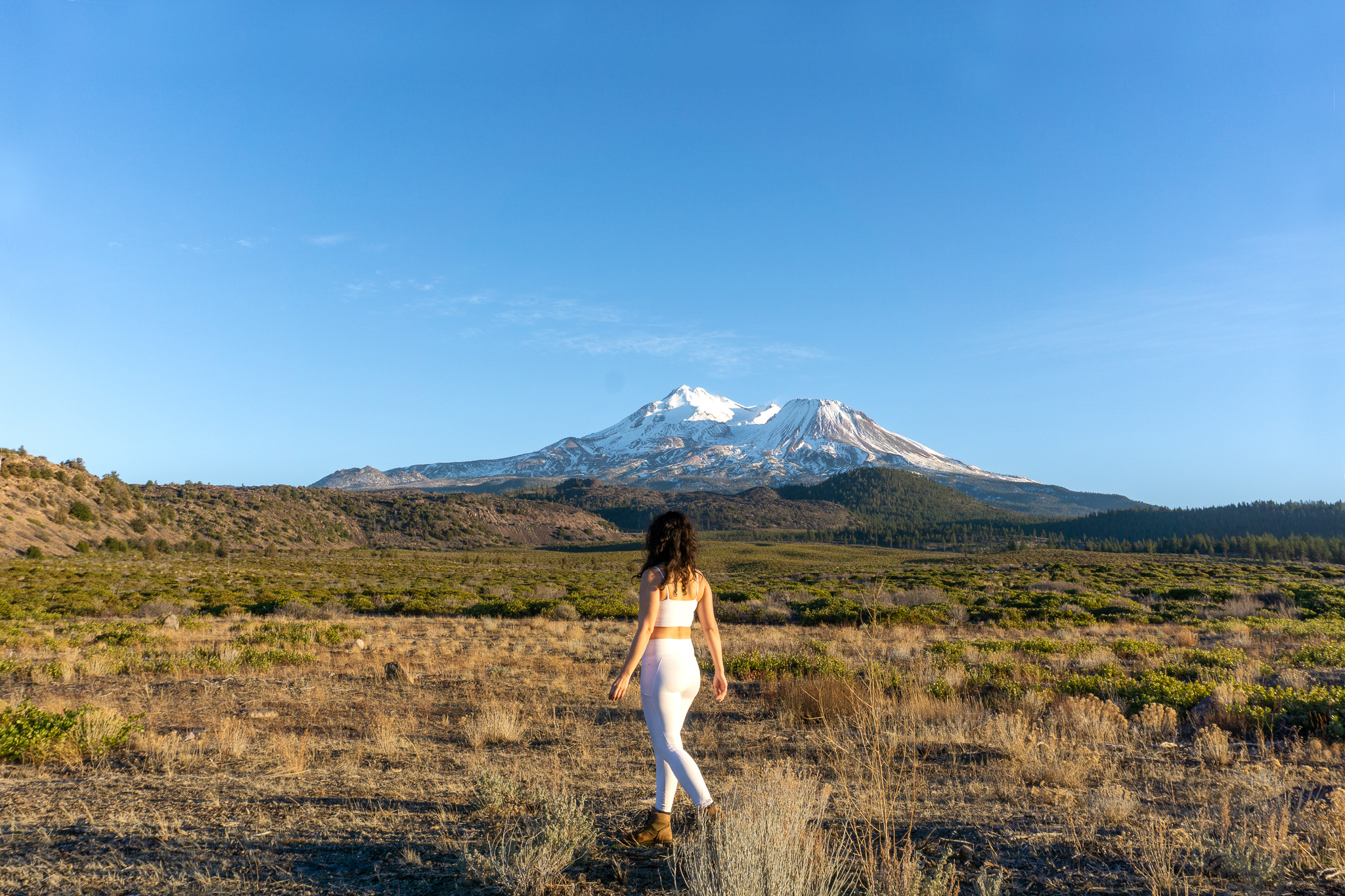 woman wearing white workout outfit at mount shasta