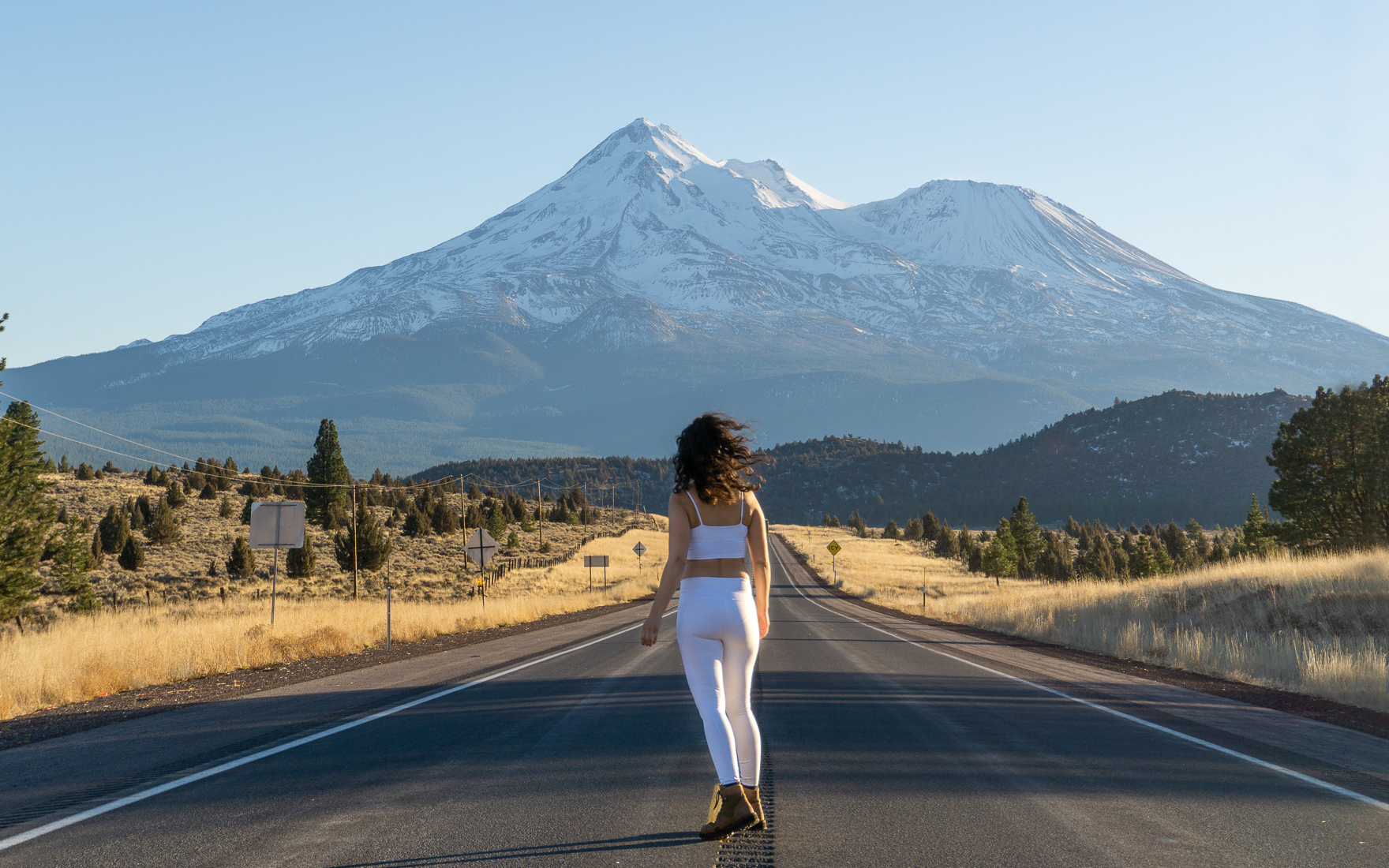 woman in road at mount shasta