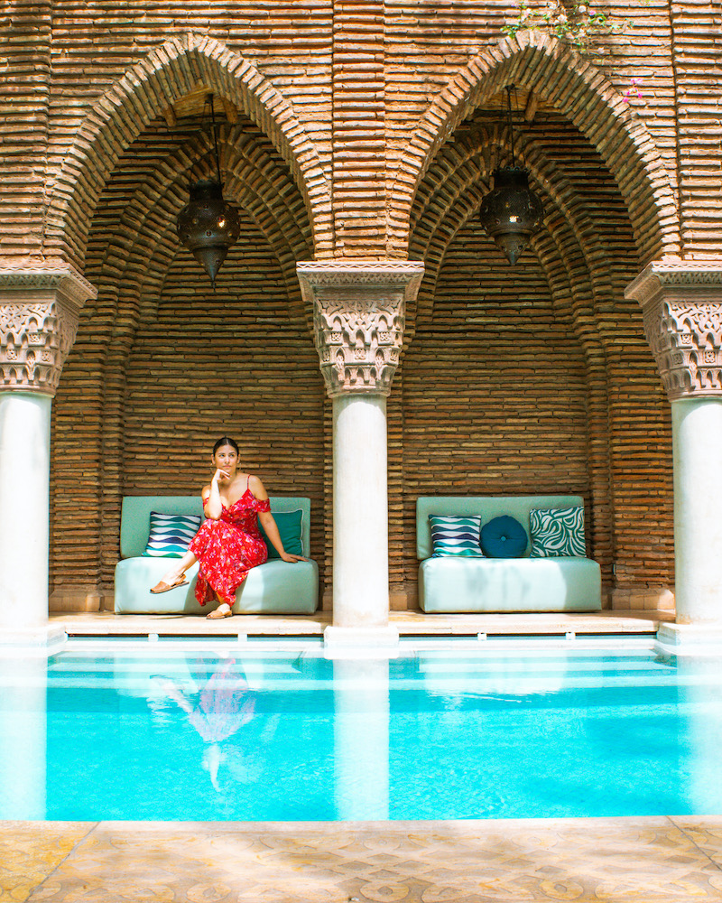 woman sitting at hotel pool