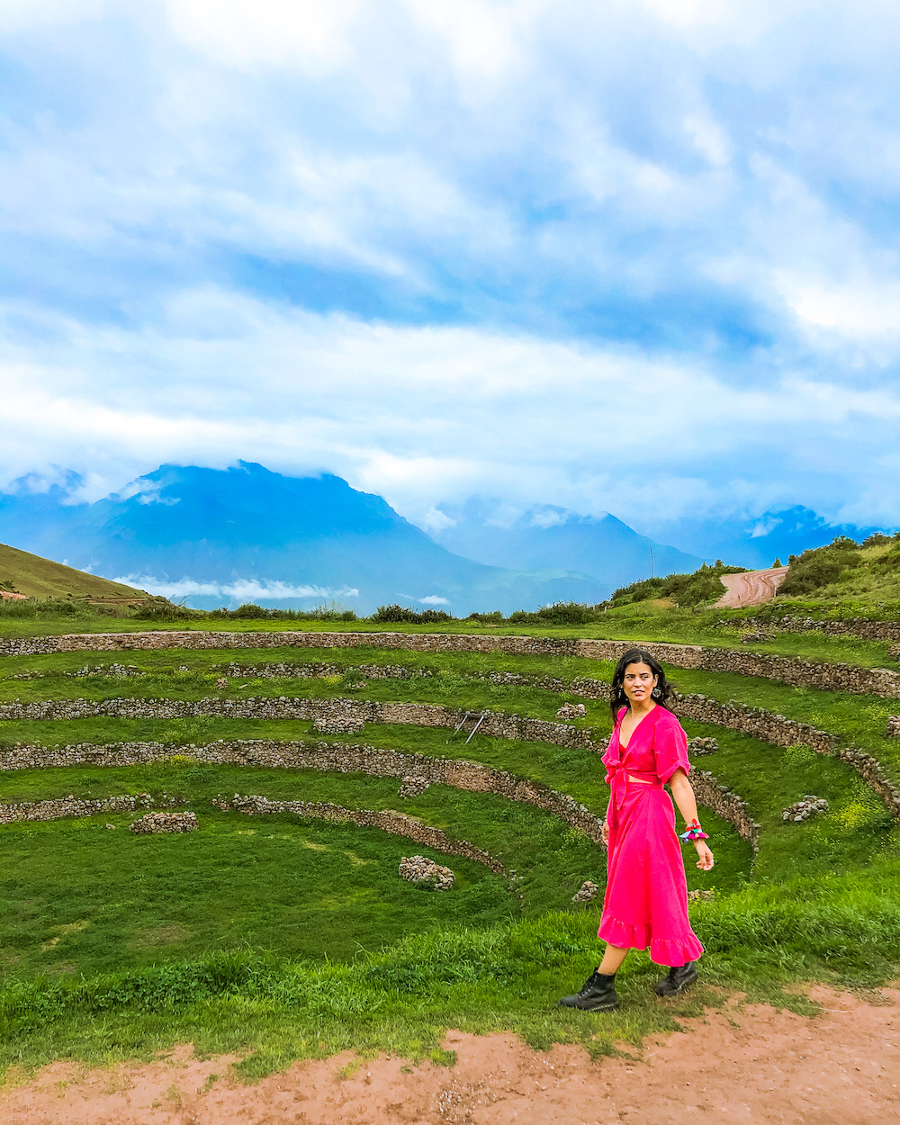 woman in pink dress at moray in sacred valley peru