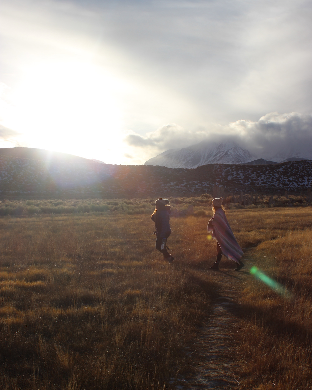 women at mono lake area at golden hour