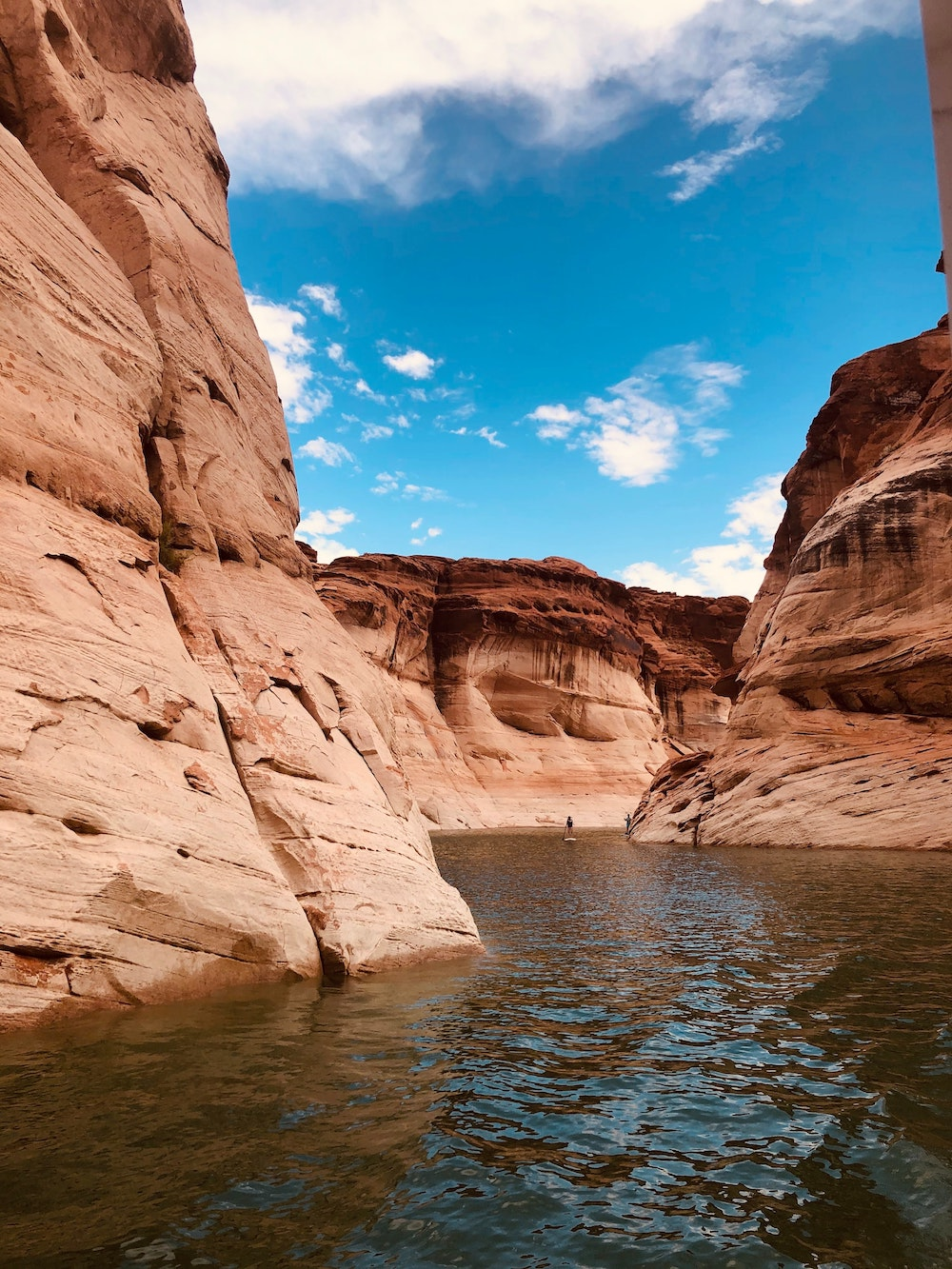 man stand up paddleboarding at lake powell page arizona