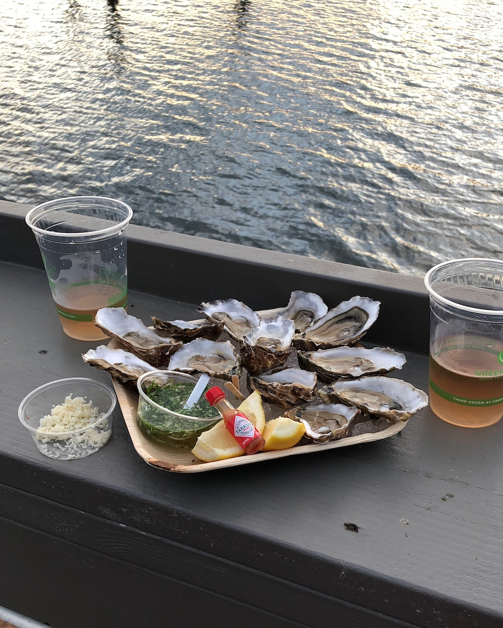 oysters with wine and a sunset view of the bay