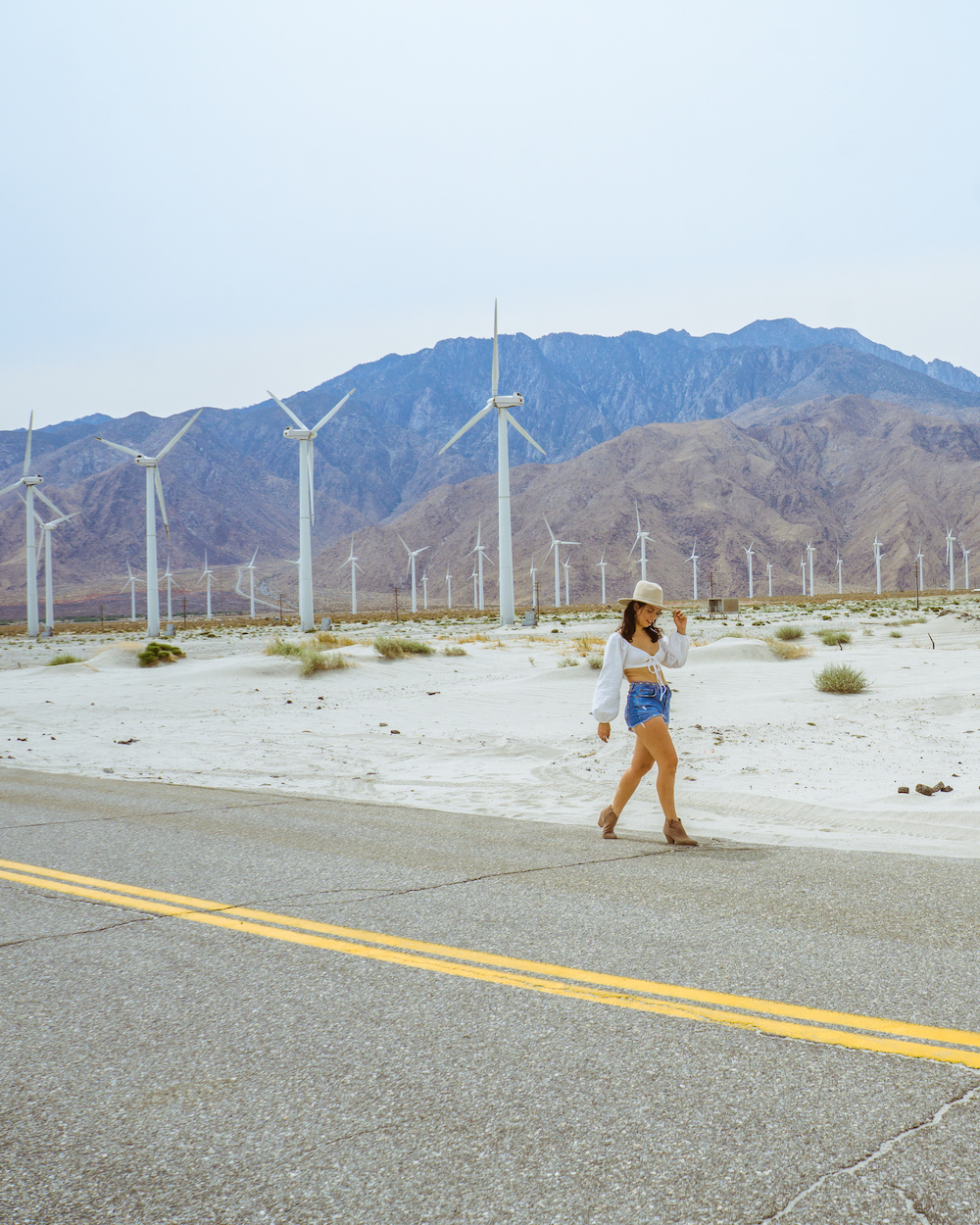 woman at windmills in palm springs