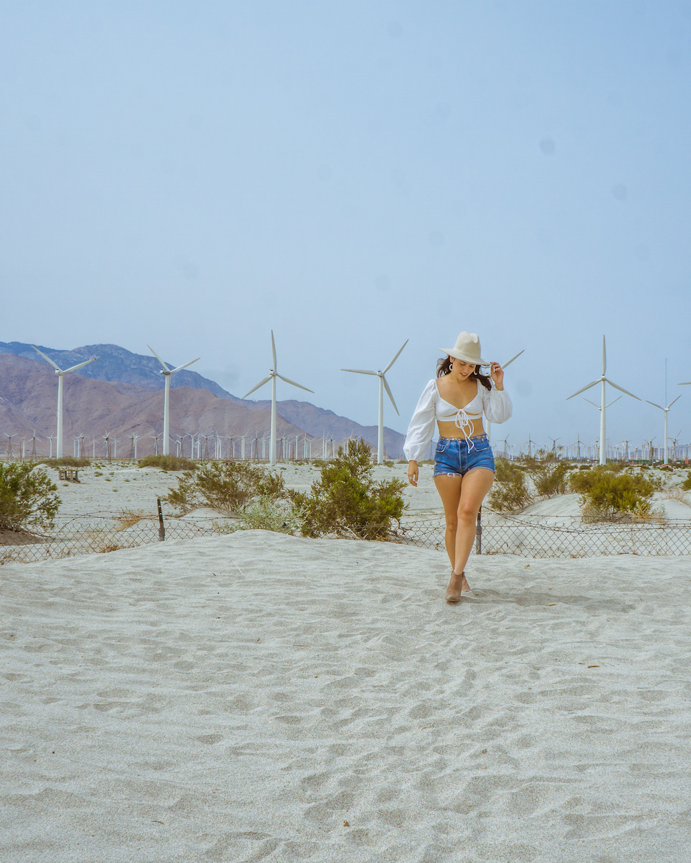 woman in western hat at palm springs windmills