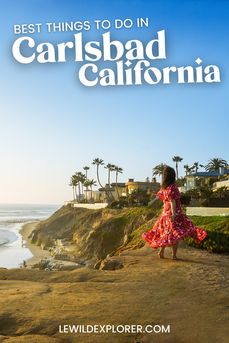 best things to do in carlsbad with woman in red dress on cliff overlooking the beach